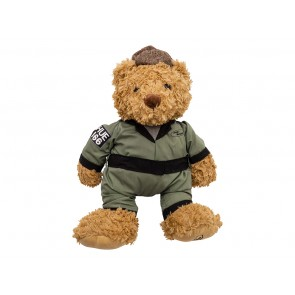 Golden brown, extra soft teddy bear with Green HUE 166 overalls and a brown flat cap.
